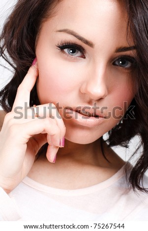 Picture of a curly brunette - stock photo
