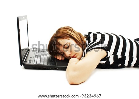 Picture of a cute teenage girl sleeping on her laptop computer. Isolated on white background - stock photo