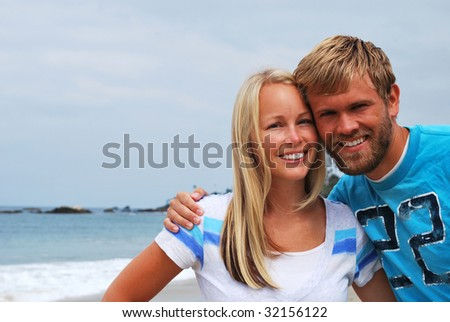 Picture of a cute young couple at the beach in california.