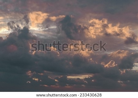 Picture of a dramatic cloudscape in the dawn. - stock photo