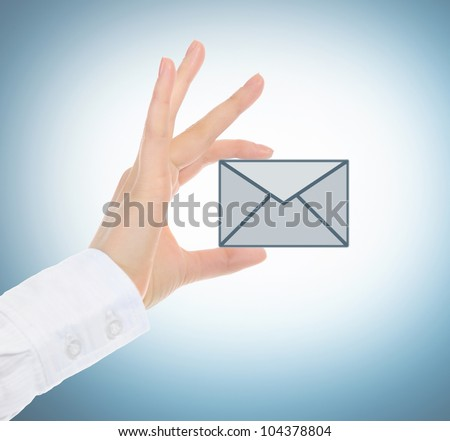 picture of a female hand holding a mail icon - stock photo