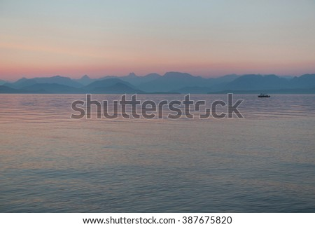 Picture of a fishing boat by sunset, taken from Quadra Island, BC,Canada.