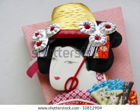 Picture of a Geisha on the backside of a racket used for the traditional game hanetsuki. - stock photo
