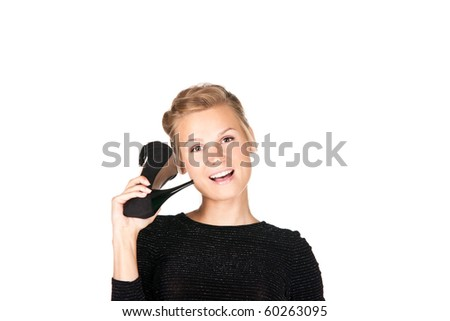 Picture of a girl in black dress with a shoe in her hand