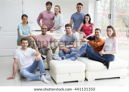 Picture of a group of friends at home. - stock photo