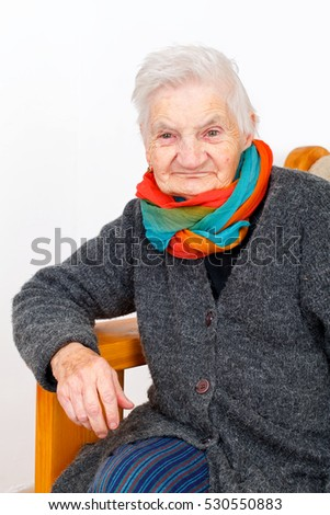 Picture of a happy elderly woman on medical therapy