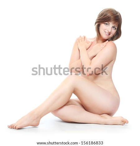 Picture of a healthy naked woman with perfect body over white.