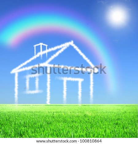 Picture of a house from white clouds against blue sky - stock photo