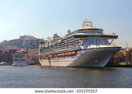 Picture of a huge ship, departing on a cruise at sunset on a summer day, Italy.