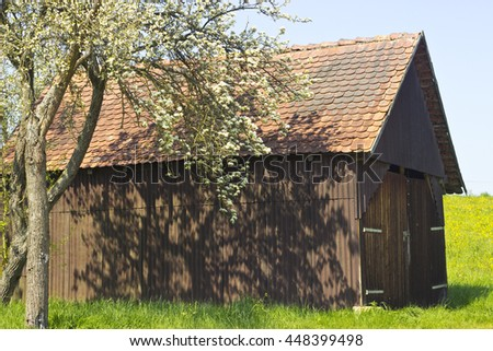 Picture of a idyllic Woodshed in Springtime - stock photo