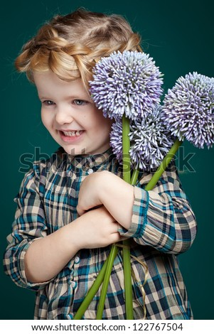 Picture of a little girl with flowers - stock photo