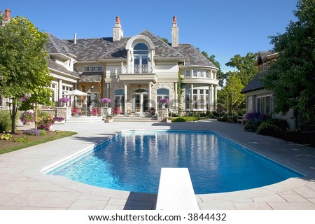 Picture of a Luxury Home Swimming Pool and Back- yard - stock photo