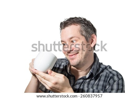 Picture of a man that cares really much about his coffee
