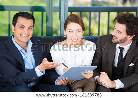 Picture of a manager, financial consultant, banker presenting to a young smiling couple a business investment opportunity plan, offering to sign it, isolated on background of city. Finance decisions