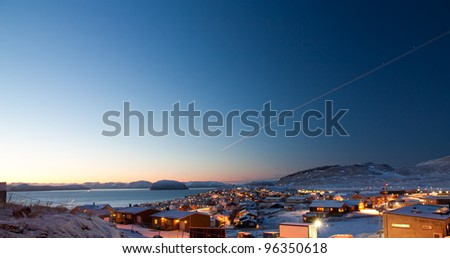 Picture of a part of the  northermost city in the world, Hammerfest. The sun is just in the horizon during day time
