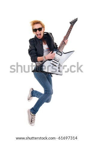 picture of a passionate woman guitarist jumping over white - stock photo