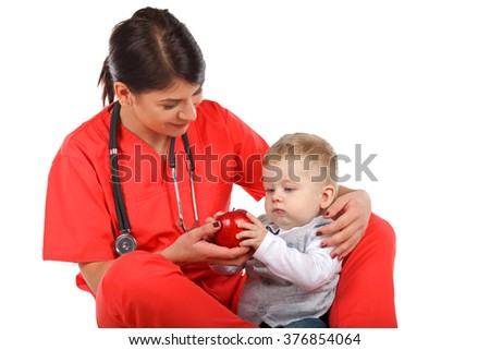 Picture of a pediatrician holding a child - stock photo