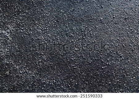 Picture of a piece of asphalt littered with salt