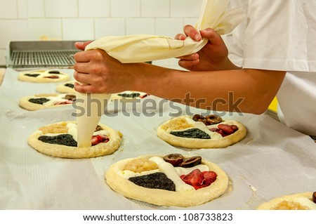 Picture of a production process of Czech traditional pies.