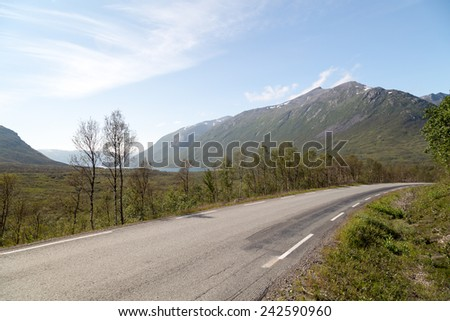 Picture of a road with scenic mountains