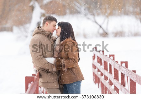 Picture of a romantic couple in winter park. outdoors photo