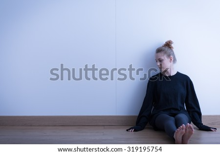 Picture of a sad teenage girl suffering from loneliness - stock photo