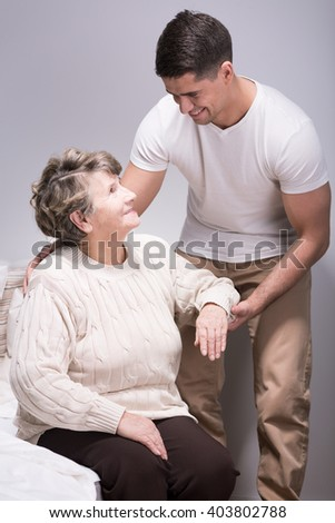 Picture of a senior woman and a young man