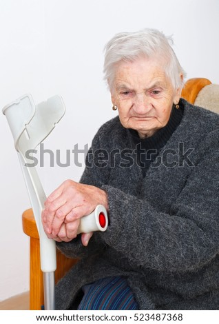 Picture of a senior woman sitting in her apartment