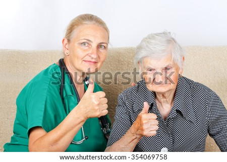 Picture of a senior woman talking with her caregiver - stock photo