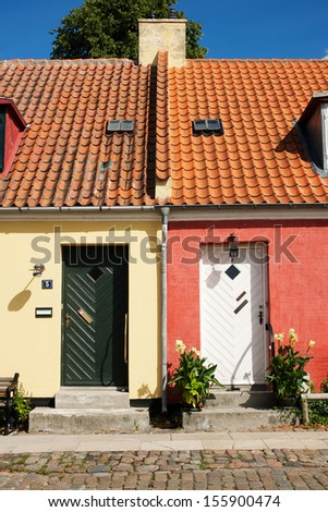 Picture of a small yellow house and a small red house - stock photo
