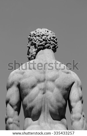 Picture of a statue of a muscular man