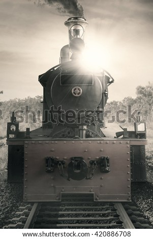 Picture of a steam engine train at the rail, shot with vintage effect - stock photo