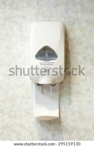 Picture of a wall mounted automatic sanitizer dispenser