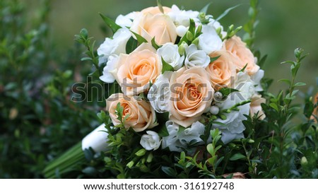 picture of a wedding bouquet , Wedding bouquet of pink and white roses lying on a green leaf, selective focus - stock photo