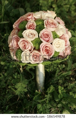 picture of a wedding bouquet , Wedding bouquet of pink and white roses lying on grass - stock photo