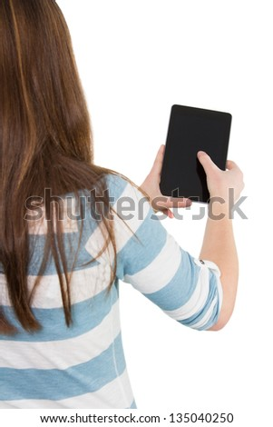 Picture of a woman using a tablet pc from behind - stock photo