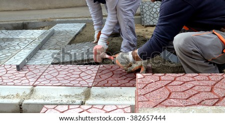 picture of a workers paving  walkway Men at work concept