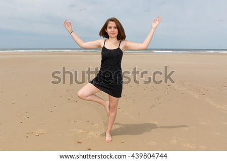 Picture of a yoga beach woman doing pose - stock photo