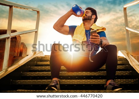 Picture of a young athletic man after training - stock photo