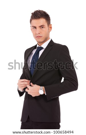 picture of a young business man buttoning his coat on whte background