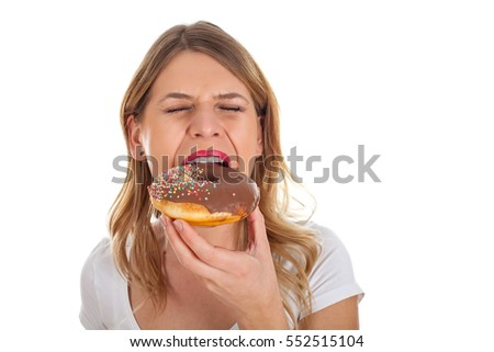 Picture of a young woman eating a delicious doughnut