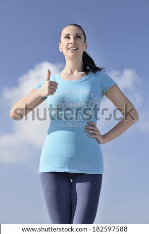 picture of a young woman has the joy of making sport on the beach - stock photo