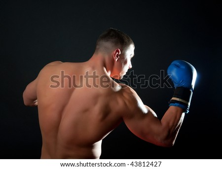 Picture of adult sportsman during boxing training - stock photo