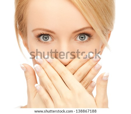 picture of amazed woman with hand over mouth - stock photo