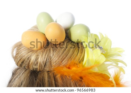 Picture of an easter girl dressed in yellow, with eggs in her hair, on a white, isolated background - stock photo