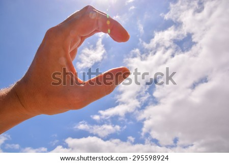 Picture of an Hand over a Cloudy Sky