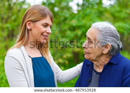 Picture of an old lady taking a walk with her granddaughter