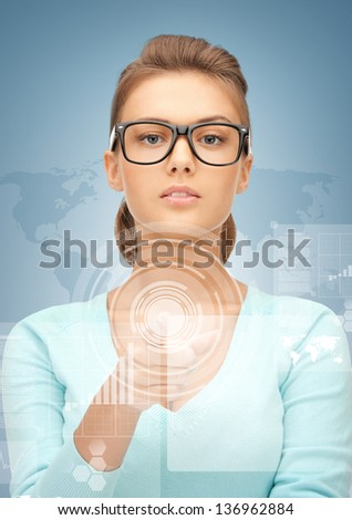 picture of attractive businesswoman pointing at virtual screen - stock photo