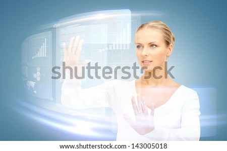 picture of attractive businesswoman touching virtual screen - stock photo