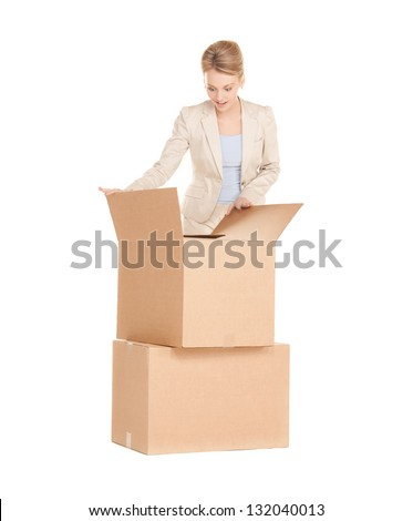 picture of attractive businesswoman unpacking big boxes
